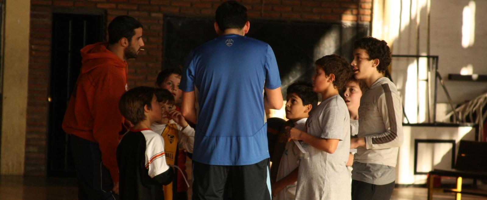 A sports player meets with his team as part of his volunteer sports coaching in Argentina